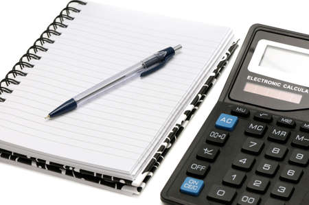 Notebook and calculator isolated on a white background                                     photo