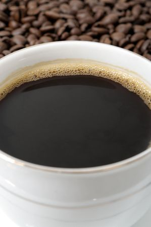 cup of coffee on a background coffee grains                                    photo