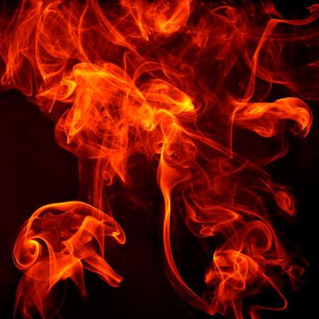 diable rouge: feu sur un fond noir