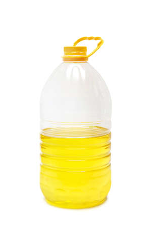 bottle with vegetable oil isolated on a white                                 photo