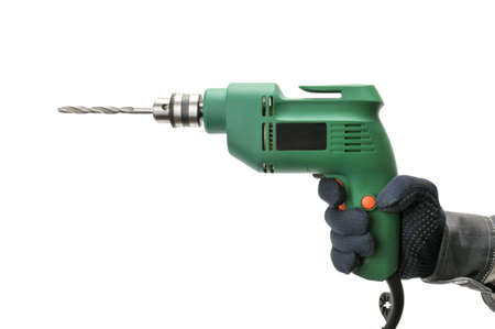 man machine: electrical drill isolated on a white