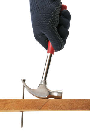 Carpenter pulls a nail. Isolated on white.                                     Stock Photo - 6477239