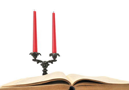 book and candles isolated on a white                                     photo