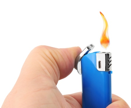 lighter in hand isolated on a white background                                     photo