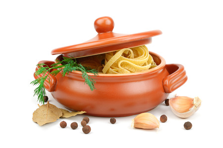 crock pot: Spaghetti in a clay pot isolated on white background