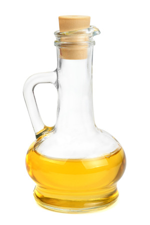 Glass carafe with vegetable oil isolated on white background                                     photo