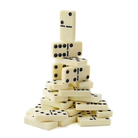 dominoes: pyramid of dominoes isolated on a white background