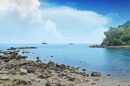 Small lagoon and sailboat on the horizon photo
