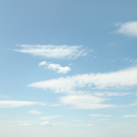 rainclouds: white fluffy clouds on sky Stock Photo