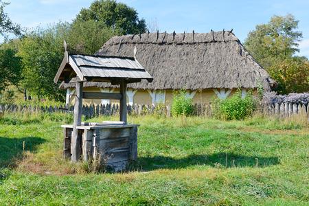 old wooden well in the Ukrainian village photo
