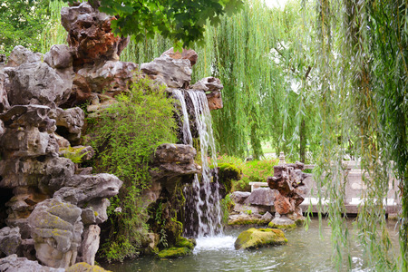 small waterfall in beautiful park photo