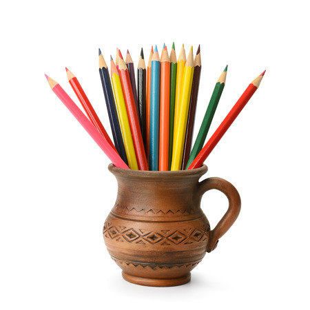 pencil in ceramic cup isolated on a white background photo