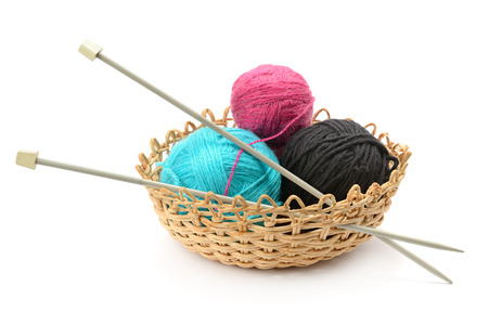 basket embroidery: Multicolored balls and needles in basket isolated on white