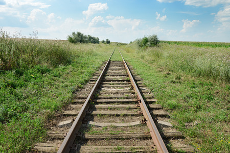 disused: disused railway track on the field Stock Photo