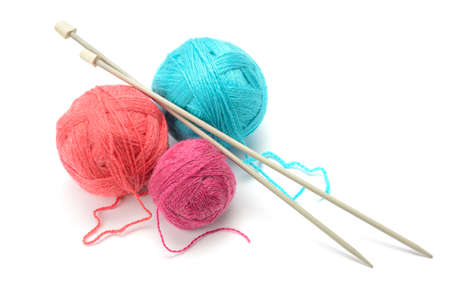 knitting: Woolen balls and knitting needles isolated on white