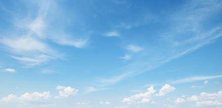 blue background: white cloud on blue sky