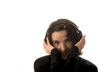 a girl in headphones listens music photo