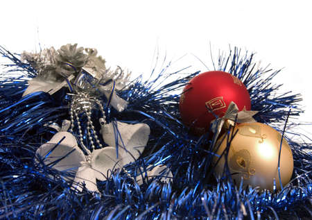 white bells and colour balls lie on blue new-year tinsel Stock Photo - 637519
