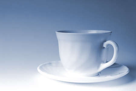 admixture: white mug of coffee on a white background, with the admixture of blue tones
