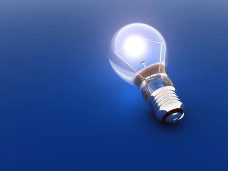 luminous bulb lies on a blue background Stock Photo - 1526728