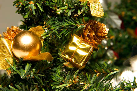 Artificial green fur-tree and New Years toys of yellow color photo