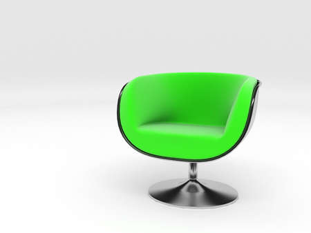 Stylish modern armchair from polished silver metal and a green material of a seat and a back Stock Photo - 2078806