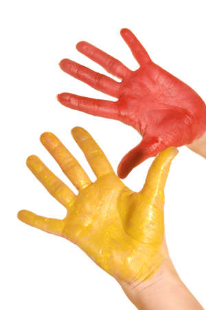 bodyscape: left and right womanish palms is painted red and yellow paints on a white background Stock Photo