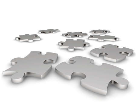 Metal components of a puzzle on a white background Stock Photo
