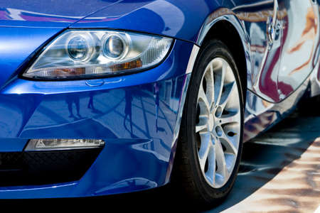car wheels: modern car in reflections on blue metallic Stock Photo