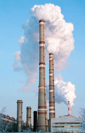 smoking pipes of factory, contaminating an environment on a background clean sky Stock Photo - 3819137