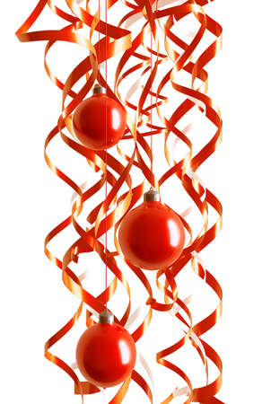 Three red Christmas toys in an environment of tinsels on a white background Stock Photo - 3819139