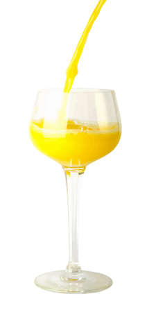 juicy: fresh brightly yellow orange juice in glass on a white background