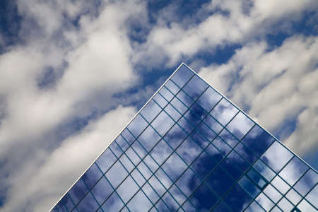 windows of skyscraper with reflections on a background cloudy sky photo
