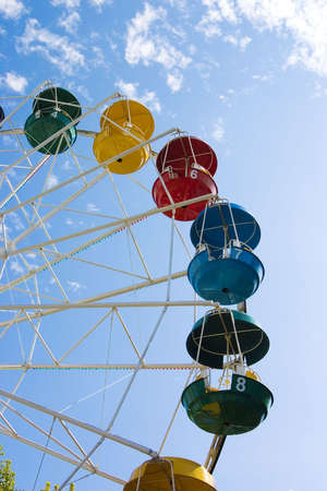 Popular attraction in park - a Ferris wheel on a background of the cloudy blue sky Stock Photo - 4480938