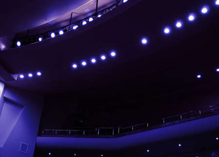 famous industries: light in a dark hall during a theatrical performance