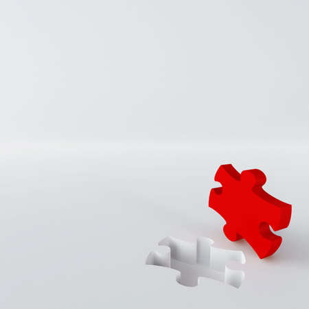 red puzzle in the corner of white surface photo