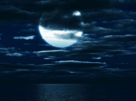 Shone circle of the moon in darkness on a background of the sea sky and clouds photo