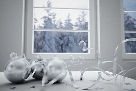 christmas balls on a background winter landscape in a window photo