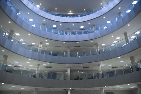 Hall of a modern business centre with set of glass show-windows Stock Photo - 5950097