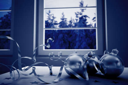 cold room: decorations on a background winter landscape in a window in christmas night Stock Photo
