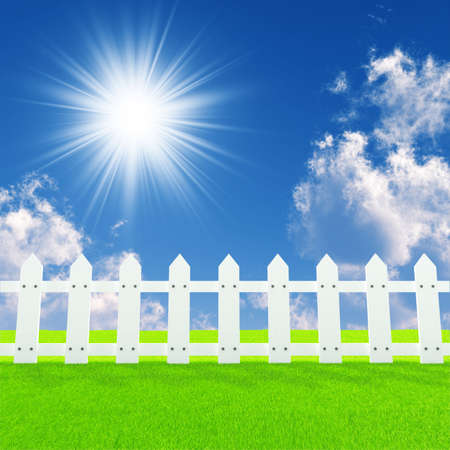 white picket fence: white fence on a summer lawn in a sun day Stock Photo