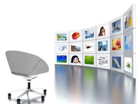 Set of monitors with static colourful and bright images and office armchair photo