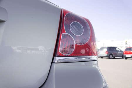 brake lights of modern gray metallic car photo