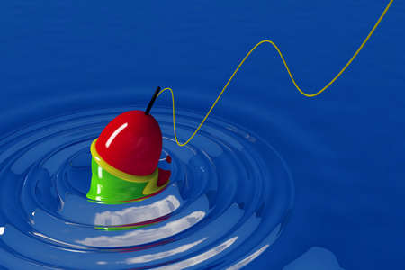 bright bobber on the smooth surface of blue water Stock Photo - 6688514