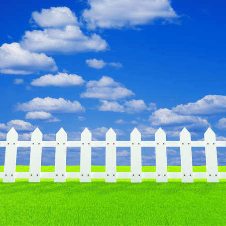 white fence on a summer lawn in a sun day Stock Photo - 6918643