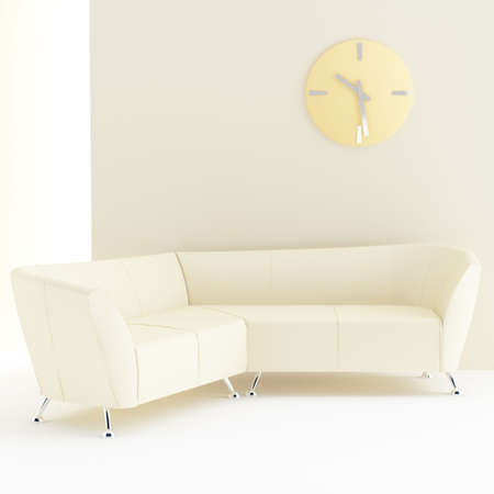 light yellow interior with sofa and clock on wall photo