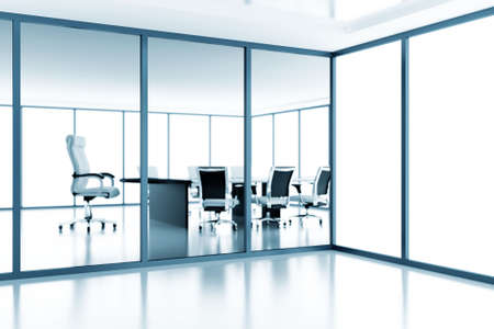 Empty meeting room behind a glass partition in modern cubicle photo