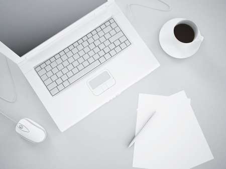 workplace with a laptop, mug of coffee, pen and paper Stock Photo - 8237767