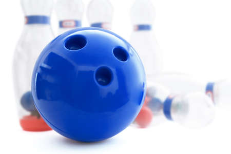 sphere standing: pins and ball for play in bowling on a white background
