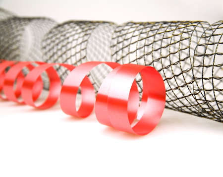 Red and mesh decorative ribbons on a white background photo
